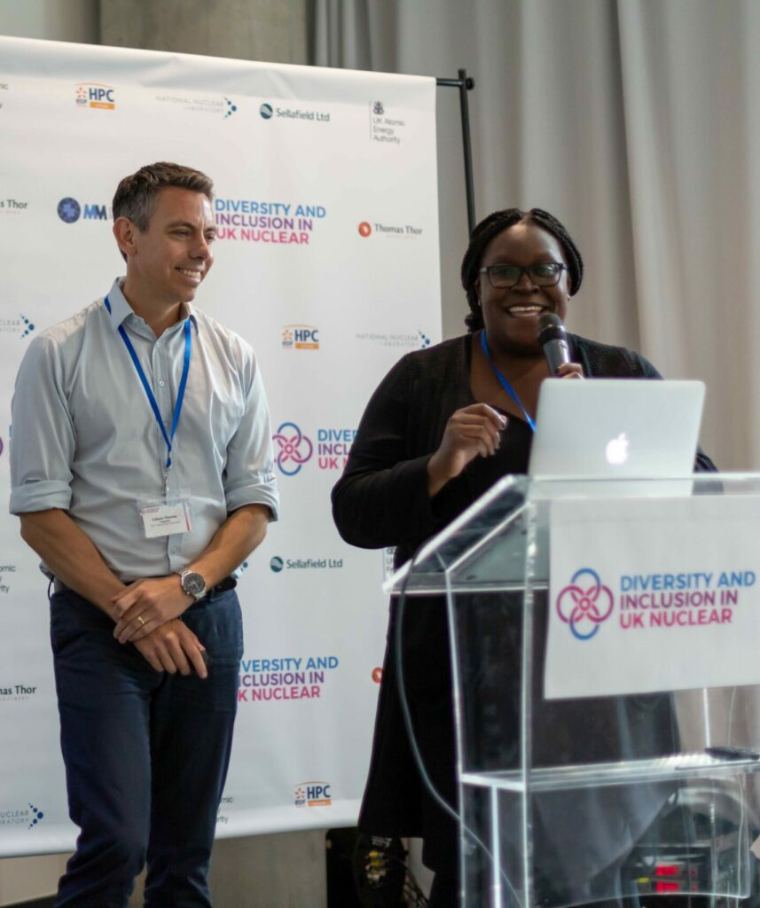 The two co-founders Callum Thomas and Monica Mwanje on stage together during our 2019 conference